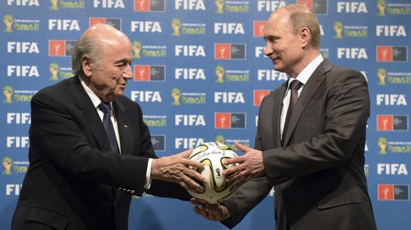 Russia's President Vladimir Putin (R) and FIFA President Sepp Blatter take part in the official hand over ceremony for the 2018 World Cup scheduled to take place in Russia, in Rio de Janeiro July 13, 2014.    REUTERS/Alexey Nikolsky/RIA Novosti/Kremlin