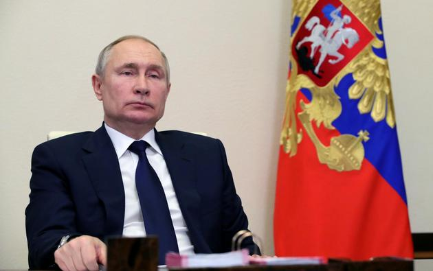 Russian President Vladimir Putin chairs a meeting with leaders of political parties outside Moscow