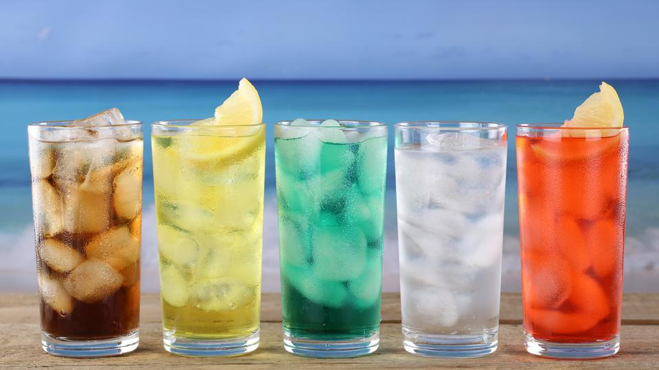 Cola and lemonade soda or soft drinks on the beach