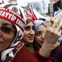 Supporters of Turkish President Tayyip Erdogan take a selfie as they wait for the start of a rally for the upcoming referendum in the Kurdish-dominated southeastern city of Diyarbakir, Turkey, April 1, 2017.  REUTERS/Murad Sezer TPX IMAGES OF THE DAY