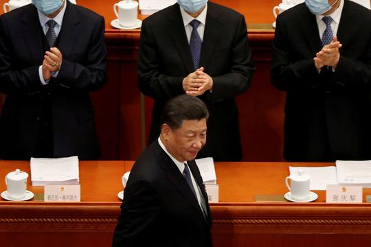 Chinese President Xi Jinping arrives for the opening session of NPC in Beijing