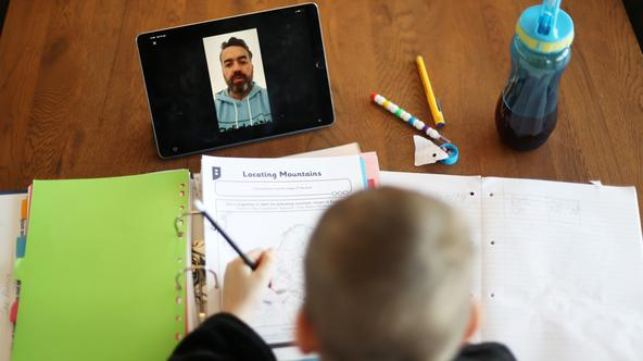 Zac receives online learning at his home in Keele
