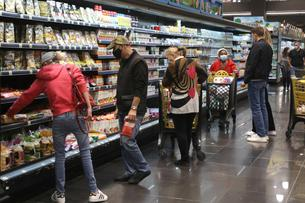People shop at a supermarket ahead of a tightened lockdown and a 24-hour curfew to curb the spread the coronavirus disease (COVID-19) outbreak in Beirut