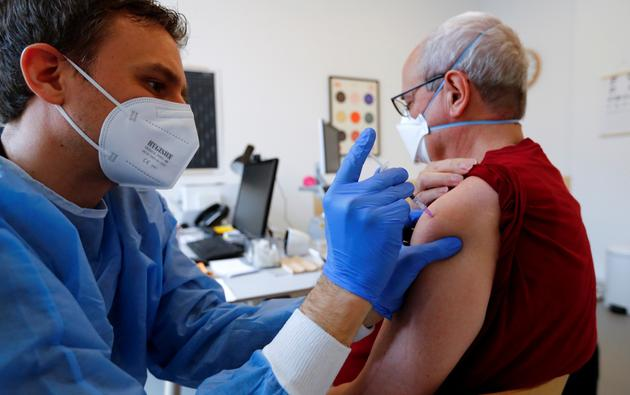 General practitioner vaccinates dose of the AstraZeneca coronavirus disease (COVID-19) vaccine in a doctors practice in Berlin