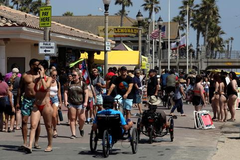 People recreate at the beach on Memorial Day weekend during the outbreak of the coronavirus disease (COVID-19) in Huntington Beach, California