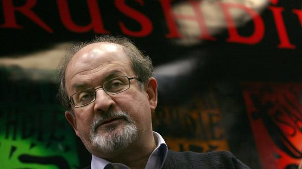 '(FILES) -  A file picture shows Indian-born British author Salman Rushdie arriving to dedicate his book in Hungarian language ay the Libri bookshop of Mammut Plaza in Budapest, 29 November 2007. Brit
