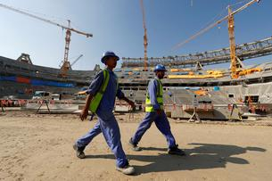 FILE PHOTO: Workers are seen inside the Lusail stadium which is under construction for the upcoming 2022 Fifa soccer World Cup during a stadium tour in Doha