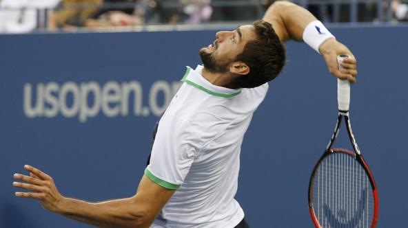 Marin Cilic of Croatia serves to Kei Nishikori of Japan during their men's singles final match at the 2014 U.S. Open tennis tournament in New York, September 8, 2014.           REUTERS/Ray Stubblebine (UNITED STATES  - Tags: SPORT TENNIS)