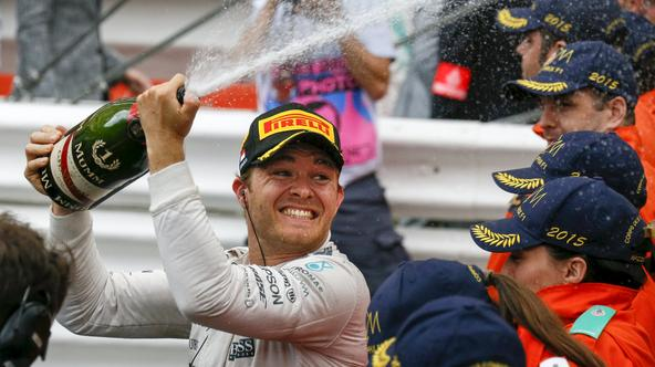 Mercedes Formula One driver Nico Rosberg of Germany sprays champagne after winning the Monaco F1 Grand Prix in Monaco May 24, 2015. REUTERS/Robert Pratta