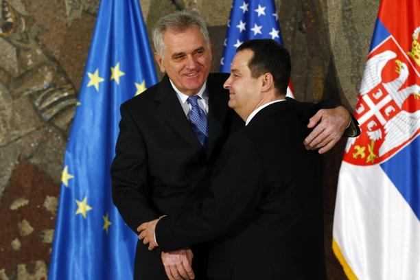 'Serbian President Tomislav Nikolic (L) hugs Serbian Prime Minister Ivica Dacic (R) prior to their meeting with U.S. Secretary of State Hillary Clinton and EU foreign policy chief Catherine Ashton in