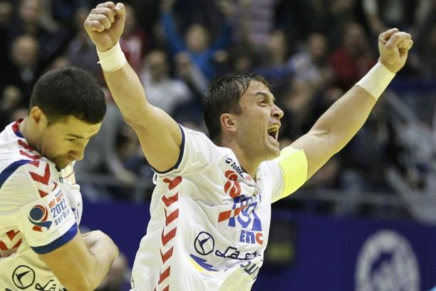 'Serbia\'s Momir Ilic celebrates a goal against Denmark during their Men\'s European Handball Championship Group A match in Belgrade January 17, 2012.               REUTERS/Marko Djurica (SERBIA  - Ta