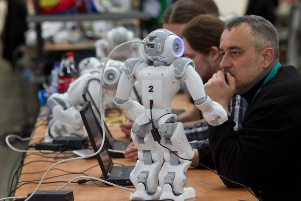 People prepare their robots of the category 'Standard Platform League' for the Robo-Cup German Open 2012 in Magdeburg, Germany, 30 March 2012. About 200 teams and more than 800 active participants take part in the competition of creations of artificial in