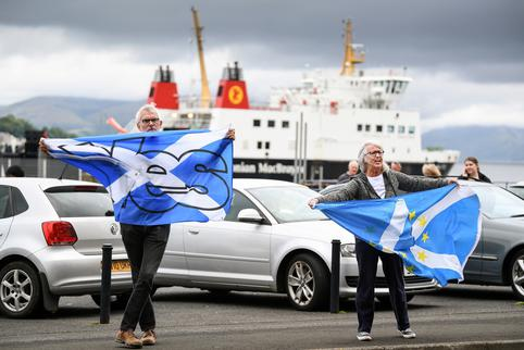 Nationalist demonstrators welcome Britain's Chancellor of the Exchequer Rishi Sunak in Rothesay