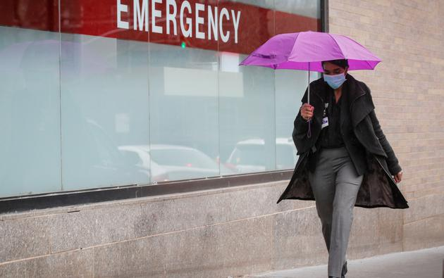 A Healthcare worker arrives at Mount Sinai Hospital, during the outbreak coronavirus disease (COVID-19)  outbreak, in New York