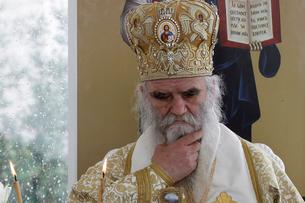 Metropolitan Amfilohije leads a prayer at Ostrog Monastery amid coronavirus restrictions, in Niksic