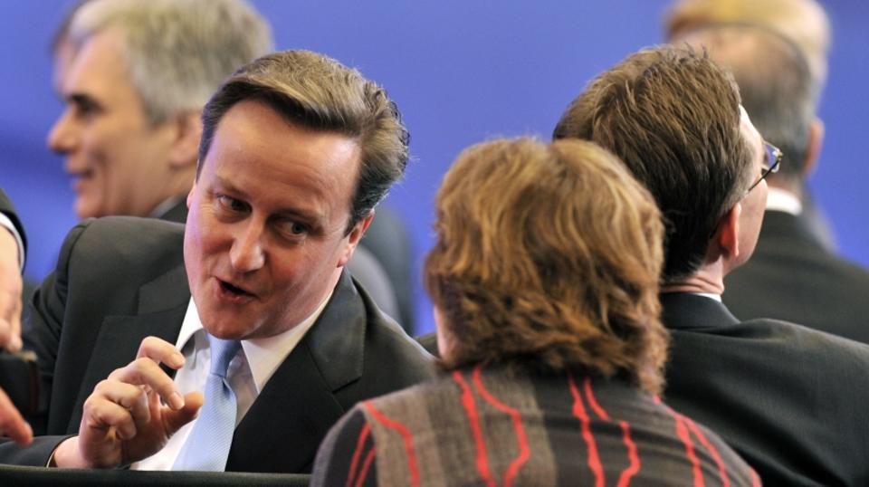 \'Britain Prime Minister David Cameron speaks with EU foreign policy chief Catherine Ashton before the signing of Croatia\'s EU accession treaty, on the sidelines of an European Union summit at the EU
