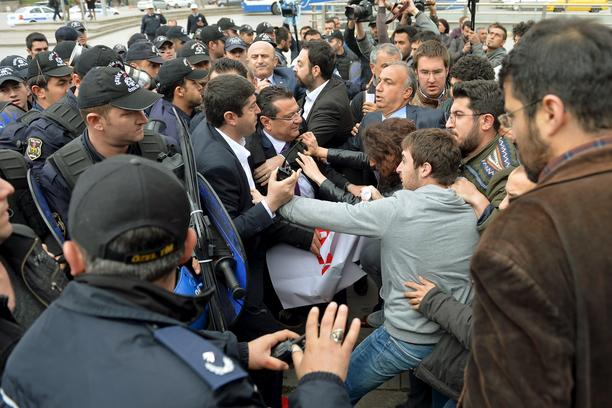 Riot police scuffle with demonstrators during a protest against parliament speaker Ismail Kahraman, outside the Turkish parliament in Ankara, Turkey April 26, 2016.