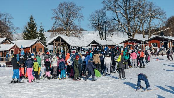 FILE PHOTO: People queue at a ski lift after the loosening of coronavirus disease (COVID-19) restrictions in the reopened resort of Zakopane