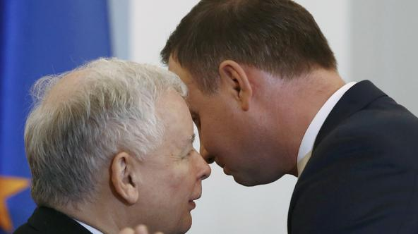 FILE PHOTO: Kaczynski, leader of PiS party, speaks with Poland's President Duda during after Szydlo was designated for the position of prime minister, at the Presidential palace in Warsaw