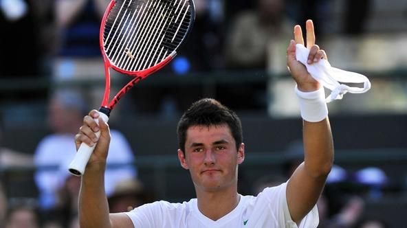 'Australian player Bernard Tomic reacts after beating Swedish player Robin Soderling during the men\'s single at the Wimbledon Tennis Championships at the All England Tennis Club, in southwest London
