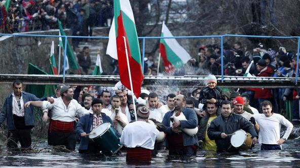 'Bulgarian men dance in the icy waters of the Tundzha river during a celebration for Epiphany Day in the town of Kalofer, some 150 km (93 miles) east of Sofia January 6, 2013. It is believed that the