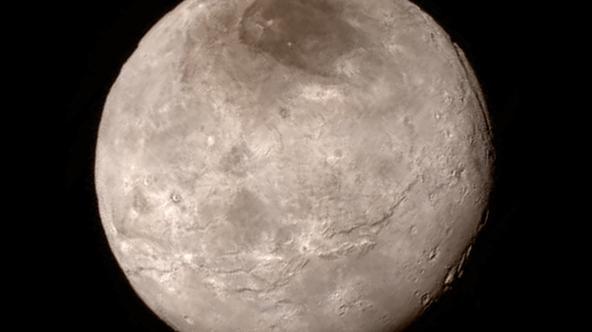 New details of Pluto?s largest moon Charon are revealed in this image from New Horizons? Long Range Reconnaissance Imager (LORRI), taken late on July 13, 2015 from a distance of 289,000 miles  (466,000 kilometers) in a picture released by NASA in Laurel,
