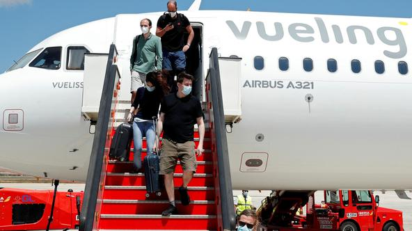 Passengers leave a Vueling plane upon their arrival at Palma de Mallorca airport on the Balearic Islands