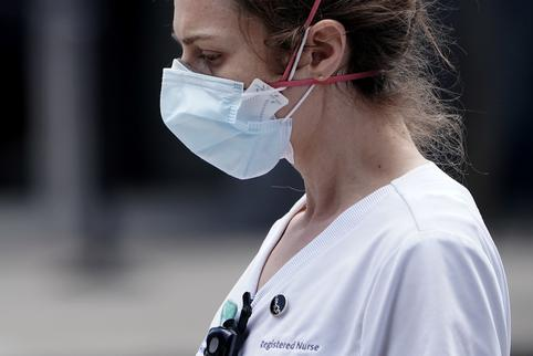A registered nurse walks out of a hospital during the outbreak of Coronavirus disease (COVID-19), in the Manhattan borough of New York City