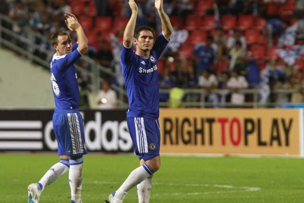 'English Premier League Chelsea\'s John Terry (L) and Frank Lampard wave to fans after their friendly soccer match against Thailand Premier League All Stars at the Rajamangala national stadium in Bang