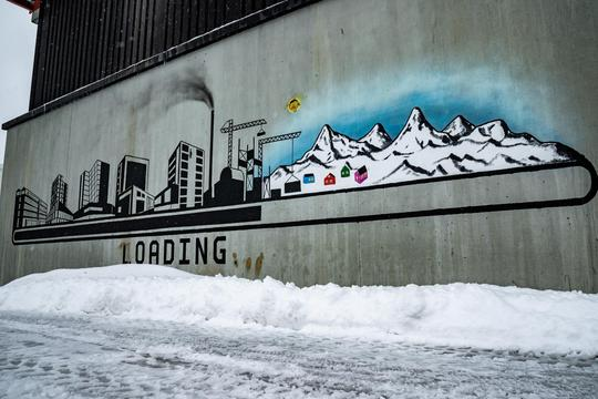 Wall painting with modern times vs traditional way of life is seen in Nuuk