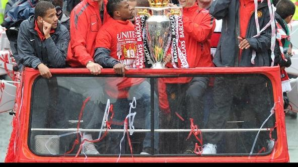 'Manchester United\'s (from left) Bebe, Edwin Van der Sar, Patrice Evra, Antonio Valencia,, Dimitar Berbatov and Luis Nani during the 2011 Barclays Premier League victory Parade through Manchester. Ph
