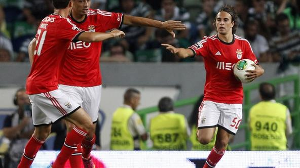 'Benfica's Lazar Markovic (R) celebrates his goal against Benfica with teammates Oscar Cardozo (2nd L) and Nemanja Matic during their Portuguese Premier League soccer match at the Alvalade stadium in