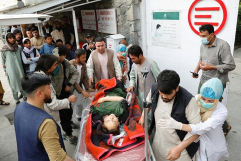 An injured woman is transported  to a hospital after a blast in Kabul
