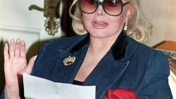 'Actress Zsa Zsa Gabor reads a statement at her home in Beverly Hills, concerning a federal court judgement of $3 million against her in this November 13, 1992 file photograph. Gabor, now in her 90s,