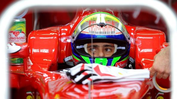 'Ferrari\'s Brazilian driver Felipe Massa sits in his car in the pits of the Hockenheimring circuit on July 24, 2010 in Hockenheim, during the third free practice session of the Formula One German Gra