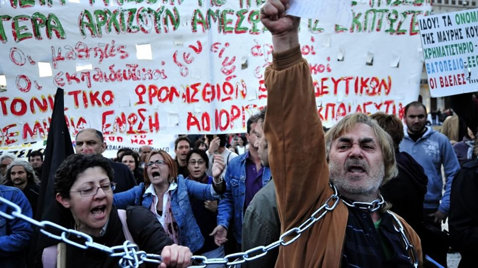 'Demonstrators shout slogans against government\'s austerity measures during a protest outside the Greek Parliament in Athens on April 27, 2010. Greece\'s central bank warned the country\'s wilting ec