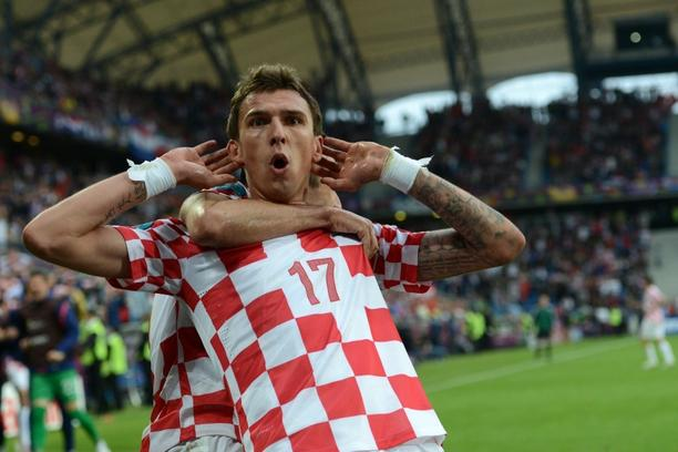 'Croatian forward Mario Mandzukic celebrates after scoring a goal during the Euro 2012 championships football match Italy vs Croatia on June 14, 2012 at the Municipal Stadium in Poznan. AFP PHOTO / FR