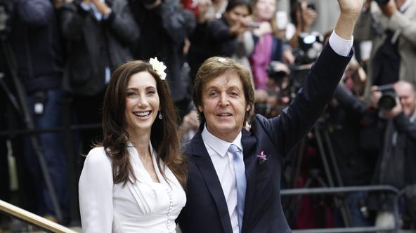 'Singer Paul McCartney and his bride Nancy Shevell leave after their marriage ceremony at Old Marylebone Town Hall in London October 9, 2011.  Former Beatle Paul McCartney wed for the third time on Su