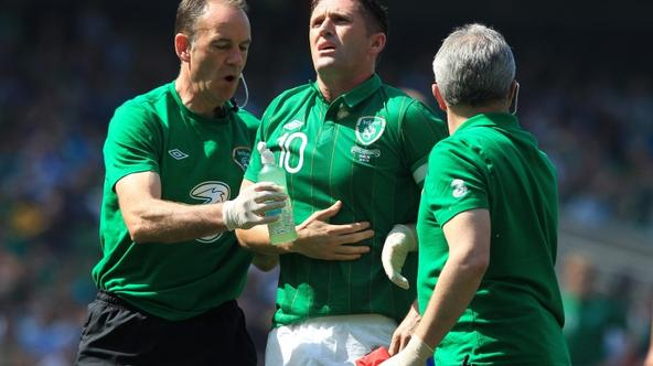 'Republic of Ireland\'s Robbie Keane (C) holds his ribs after being kicked during an international friendly football match against Bosnia-Herzegovina at the Aviva stadium in Dublin on May 26, 2012. AF