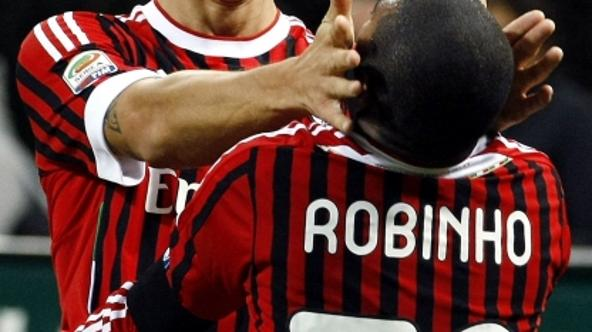 'Ac Milan\'s Robinho (R) is celebrated by his team mate Zlatan Ibrahimovic after scoring a second goal against Palermo during their Italian Serie A soccer match at the San Siro stadium in Milan Octobe