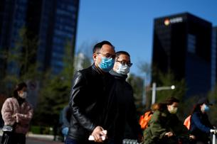 People wear masks as they head to work during morning rush hour amid the outbreak of  coronavirus disease (COVID-19) in Beijing