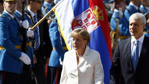 \'Serbia\'s President Boris Tadic (R) and German Chancellor Angela Merkel review a guard of honour before their meeting in Belgrade August 23, 2011. Merkel is on an official two-day visit to Serbia.