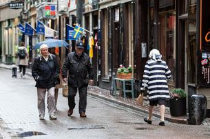 People stroll in Old Town of Stockholm