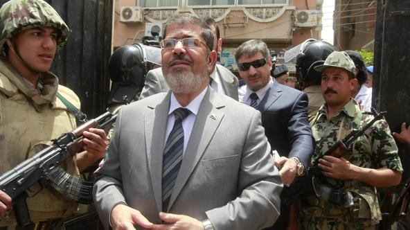 'Islamic presidential candidate Mohamed Mursi arrives at a polling station to cast his vote in Al-Sharqya, 60 km (37 miles) northeast of Cairo, in this May 23, 2012 file photo. Egypt\'s deposed Presid