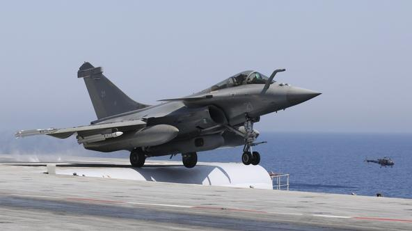 'A Rafale fighter jet makes a catapult launch on the flight deck, where in two seconds the jet goes from 0 to 250 kms per hour, aboard France\'s flagship Charles de Gaulle aircraft carrier March 28, 2