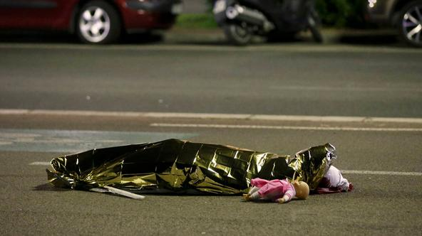 ATTENTION EDITORS - VISUAL COVERAGE OF SCENES OF INJURY OR DEATH - A body is seen on the ground in Nice, France July 15, 2016 after the Bastille Day truck attack by a driver who ran into a crowd on the Promenade des Anglais that killed scores on July 14.