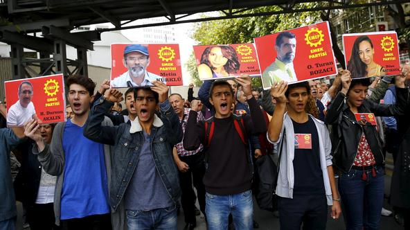 Members of the left-wing Labour Party (EMEP) carry pictures of the victims of Saturday's bomb blasts during a commemoration in Ankara, Turkey, October 11, 2015. Turkish investigators worked on Sunday to identify the perpetrators and victims of Saturday's