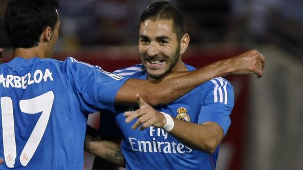 'Real Madrid\'s Karim Benzema (R) celebrates with teammate Alvaro Arbeloa after scoring a goal against Granada during their Spanish first division soccer match at Los Carmenes stadium in Granada Augus