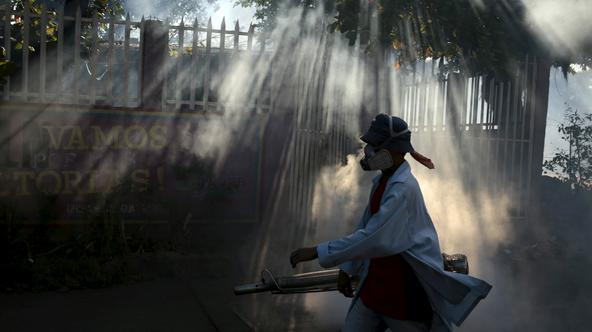 A health ministry worker fumigates a house to kill mosquitoes during a campaign against dengue and chikungunya and to prevent the entry of Zika virus in Managua, Nicaragua January 26, 2016. The Government of Nicaragua announced a plan in order to stop the