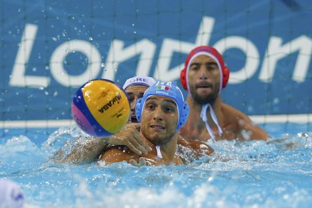 'Greece\'s Evagelos Delakas (L) challenges Italy\'s Deni Fiorentini (C) during their men\'s preliminary round Group A water polo match at the Water Polo Arena during the London 2012 Olympic Games July
